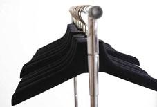 Row of empty clothing hangers on rack